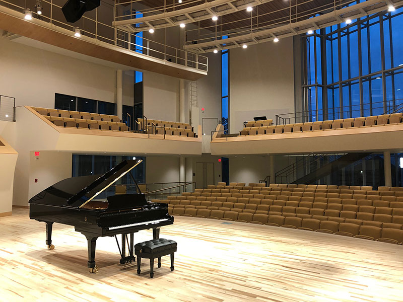 Piano on stage at the Recital Hall at Penn State