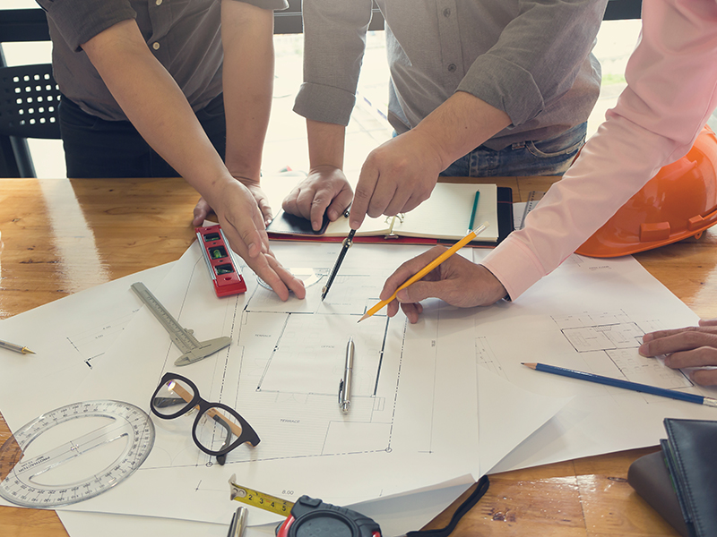 Engineers showing leadership while reviewing a project